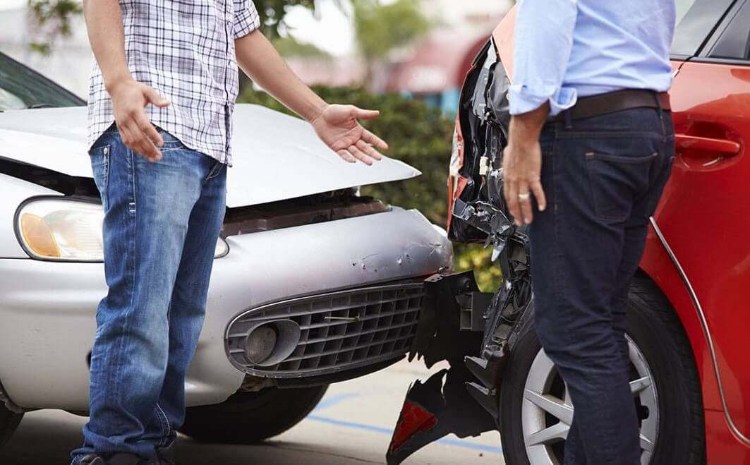 How does auto crash cause a herniated disk?